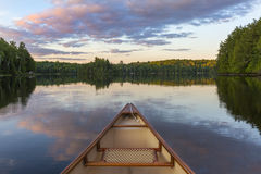 Bow of a canoe on a lake in Ontario, Canada. Bow of a canoe on a lake - Haliburton, Ontario, Canada stock photo