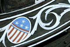 Bow Carving. Carving of the stars and stripes on the bow of the USS Constitution in Boston Harbor Stock Image