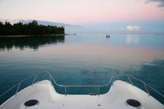 Bow of catamaran boat at sunset Stock Photos