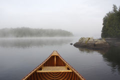 Bow of a Cedar Canoe on a Misty Lake Royalty Free Stock Photography