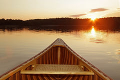 Bow of Cedar Canoe at Sunset. Bow of Cedar Canoe Paddling into the Sunset stock images