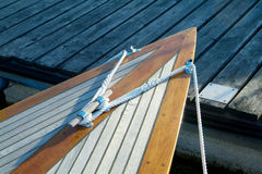 Bow of classic sailboat. Bow of classic, wooden sailboat with teak-deck Stock Photography