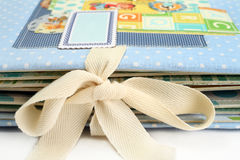 Bow close-up. Album handmade tied with a bow. Royalty Free Stock Photo