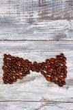 Bow from coffee beans. Royalty Free Stock Photos