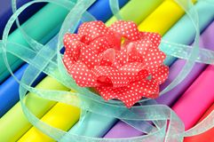 Bow and colorful gift wrap Royalty Free Stock Photography