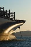 The bow of a container ship anchored in the sunlight. Stock Image