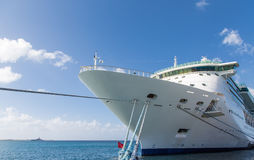 Bow of Cruise Ship with Ropes to Pier. Luxury Cruise Ship Anchored Under Nice Skies at Harbor on St Croix Stock Image