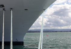 Bow of Cruise ship in Rotorua NZ. Bow of a cruise ship docked in the harbor with the focus on the bollards and ropes mooring the boat to the harbour wall Stock Photography