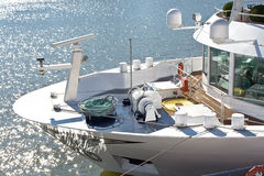 Bow and deck of the ship. Beside glistening water Royalty Free Stock Photography