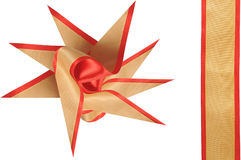 The bow decorates a gift. The beautiful bow from a beige and red band decorates a gift Stock Photos