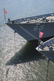 Bow of a docked US warship. The bow of a grey US warship docked in the harbour Stock Image
