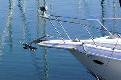 Bow End of a Boat. The front of a private watercraft with an anchor and spotlight Stock Photo