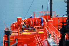 Bow with equipment and sailors of LPG tanker Stock Photo