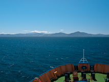 The bow of a ferry. With the coast on the horizon Royalty Free Stock Images