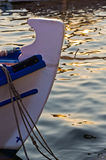 The bow of a fishing boat at sunset in Porto Koufo harbor, Sithonia Stock Photos