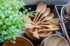 Bow of fork and spoon in pantry. With plant royalty free stock image