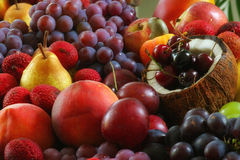 Bow full of colorful fresh fruits. Grapes, mango, apples, pear and others Stock Image