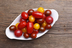 Bow full of fresh heirloom tomatoes. A variety of heirloom cherry tomatoes in a bowl Royalty Free Stock Photography