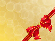 Bow on the gold. Red bow on the gold Royalty Free Stock Image