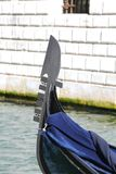 Bow of the gondola on the Canal in Venice Stock Photo