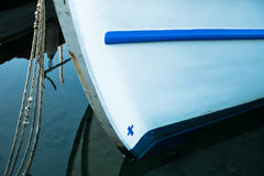 The bow of a greek fishing boat in a harbor at morning Stock Photography