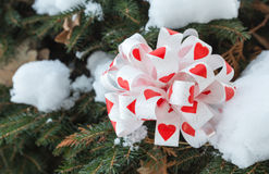 Bow with hearts as a christmas decoration. Royalty Free Stock Photo