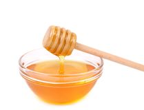 Bow of honey and wooden spoon. Stock Photography