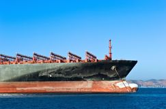 The bow of a huge container ship at at anchored in the roads. Royalty Free Stock Image
