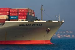 The bow of a huge container ship Humber Bridge anchored. Nakhodka Bay. East (Japan) Sea. 19.04.2014 Stock Images