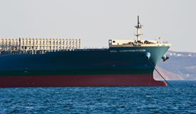 The bow of a huge container ship MOL Contribution anchored. Nakhodka Bay. East (Japan) Sea. 31.03.2014 Stock Image