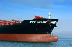 The bow of a huge container ship MSC Meline anchored. Nakhodka Bay. East (Japan) Sea. 22.07.2015 Royalty Free Stock Photos