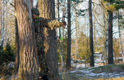 Bow hunter camouflage. Bow hunter standing with draw bow in the shade of an tree in his extreme camouflage suit. hard to spot him Stock Images