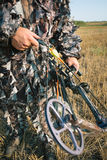 Bow hunter. Hunter in camouflage with his bow Stock Photo