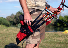 Bow hunter hands holding compound bow Stock Image