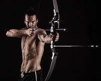 Bow-hunter with a modern compound bow Stock Photos