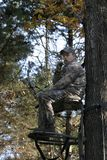 Bow Hunter Waiting in Tree Stand 2 Stock Photo