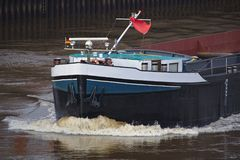 Bow of inland vessel running at high speed with white foaming bow wave Royalty Free Stock Photos