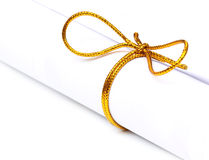 Bow knot on a scrolled paper. Over white background Royalty Free Stock Images