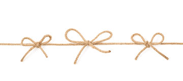 Bow knots on a string isolated Royalty Free Stock Images