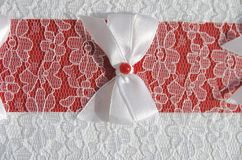 Bow on lace fabric Stock Images
