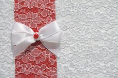 Bow on lace fabric Stock Image