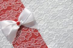 Bow on lace fabric Royalty Free Stock Photography