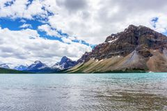 Bow Lake and Crowfoot Mountain. In Banff National Park, with Crowfoot Glacier in the background. Located at the base of Bow Summit, the lake is fed by Bow stock photography