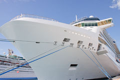 Bow of Luxury Cruise Ship. A huge luxury cruise ship tied to a pier with blue and white ropes Stock Photography
