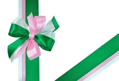 Bow made of Green and Pink Ribbons. Festive Bow made of Dark Green, Light Green and Pink Ribbons Isolated on White Stock Photography