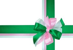 Bow made of Green and Pink Ribbons. Festive Bow made of Dark Green, Light Green and Pink Ribbons Isolated on White Royalty Free Stock Photo