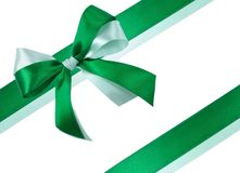 Bow made of Green Ribbons Isolated. Festive Bow made of Dark Green and Light Green Ribbons Isolated on White Royalty Free Stock Photos