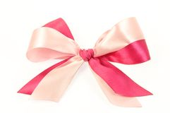 Bow made of Pink Ribbons. Isolated on white Royalty Free Stock Images