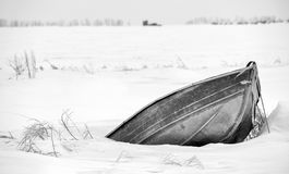 Bow of metal canoe in deep snow Royalty Free Stock Photo