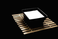 Bow of milk. Bowl of milk on a wooden base Royalty Free Stock Photos